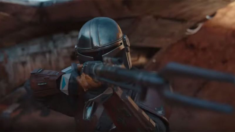 The Mandalorian with his gun taking aim