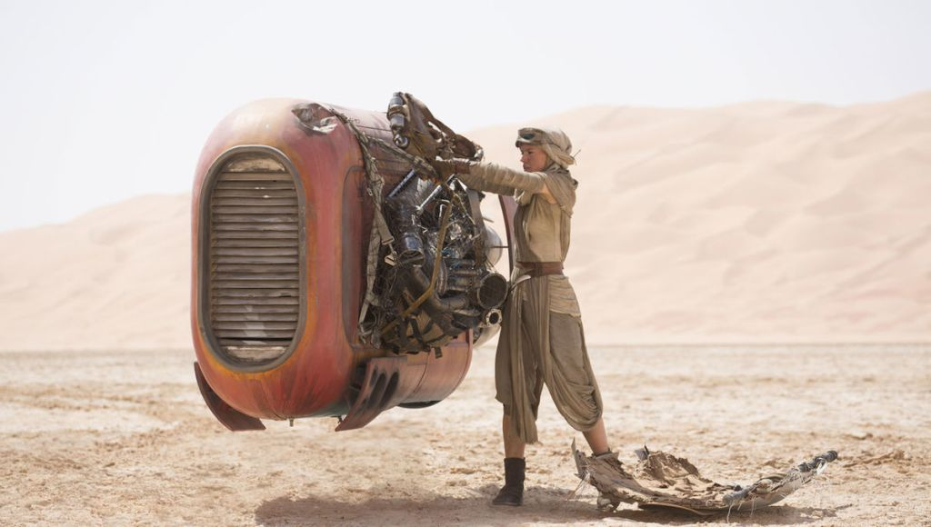 Rey on Jakku with her speeder