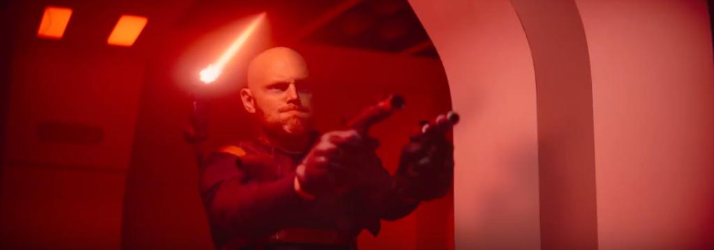Bill Burr's Mandalorian character in a shootout