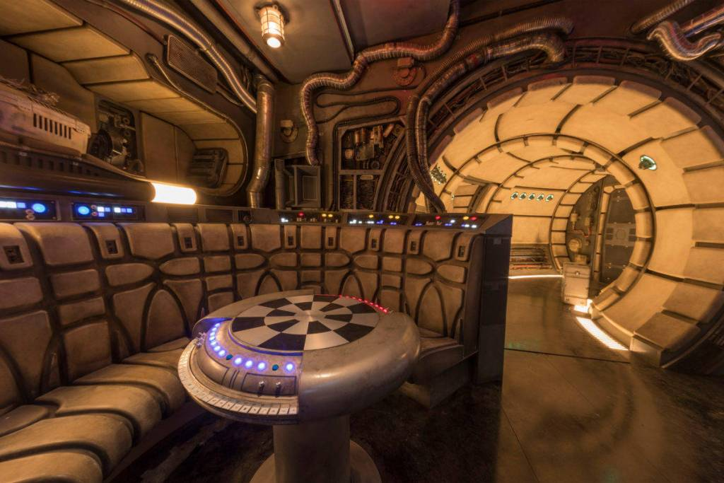 This is where you get recruited by Hando Ohnaka to do some work for pirates. A fun interactive game that allows you to enter the Falcon and even sit at the Dejarik table. You'll be put in groups of 6, where you break up to pilot, shoot, and repair the ship to escape the clutches of the First Order.