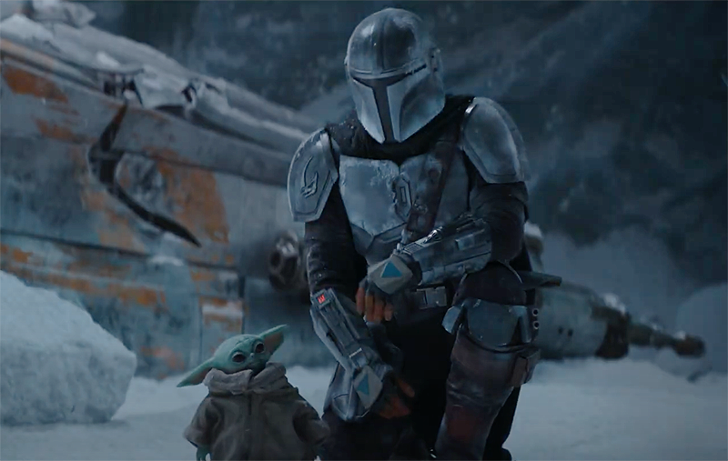 Here we have Mando flying up on an ice planet, which will be different than the one in the first scene unless he returns to it. But here we can see his ship is in great condition and he and baby Yoda are most likely safe. From the shots later on in the trailer, it looks like they are going be exploring that crevice that they flew over and the shot following this one is most likely them landing on this very planet.